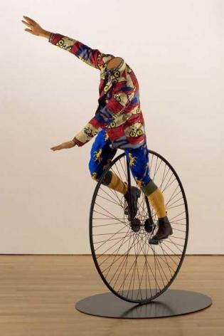 YINKA SHONIBARE, Man on Unicycle, 2005. Life-size fiberglass mannequin, Dutch wax-printed cotton, steel