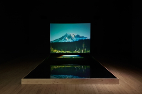 BILL VIOLAMoving Stillness: Mount Rainier 1979,1979Color videotape playback with rear projection reflected off water surface of a pool in a large, dark room; aquarium aerator with timing circuit; amplified stereo sound, Continuously Running