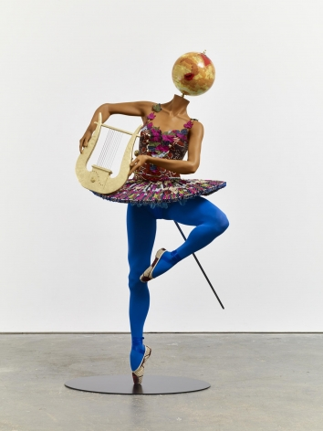, YINKA SHONIBARE, MBE Ballet God (Apollo), 2015 Fibreglass mannequin, Dutch wax printed cotton textile, lyre, sword, globe, pointe shoes and steel baseplate 75 15/16 x 33 13/16 x 33 7/16 in. (193 x 86 x 85 cm)