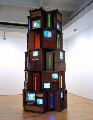Tower of televisions of various sizes, from many eras