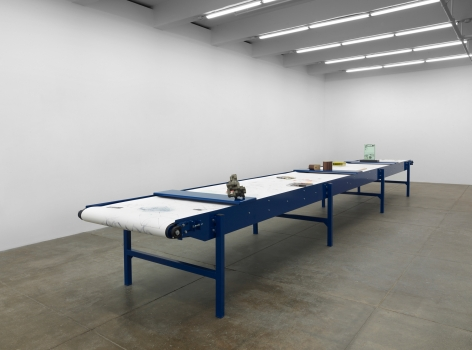 """Goshka MacugaBefore the Beginning and After the End: Artists' Systems (in collaboration with Patrick Tresset), 2016Blue table with vitrines, biro drawings by system """"Paul-n"""" on paper scrolls, artworksandobjectsDimensions variable"""