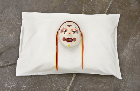 Jamie IsensteinFire in the Eyes, 2015Pillow, mask, oil lamp6 x 29 x 20 in (15.2 x 73.7 x 50.8 cm)