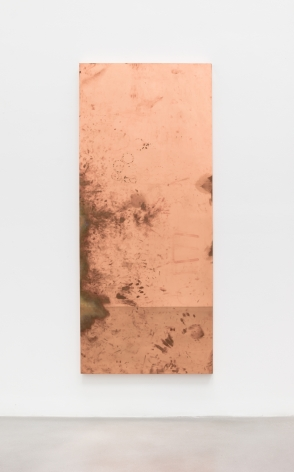 Rectangular copper surrogate with lots of marks on it from where desk was touched and worked on.