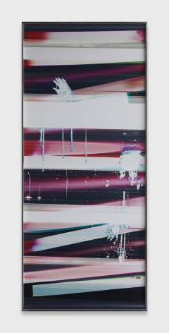 Large color photographic print with stripes in blue, pink, red, and white. There is a hand print in the center of the upper third of the print.