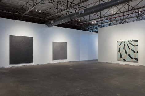 Installation view of Bleckner's show at Dallas Contemporary in 2017. The shot includes a large black square canvas, a square gray canvas, and a blue and gray dome painting.