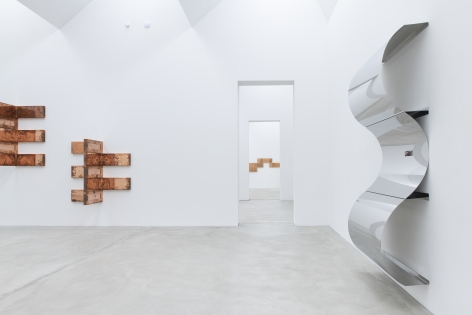 Installation view of Beshty's exhibition at Kunst Museum Winterhur featuring a large steel surrogate and copper surrogates.