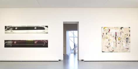 Two of Adam McEwen's limousine works hang together vertically. His work is pictured alongside other works included at La Fondation Louis Vuitton.