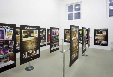 installation of All you need is Data at the Kunstverein Munich in 2013, featuring several large prints mounted on steel banisters in the center of the room
