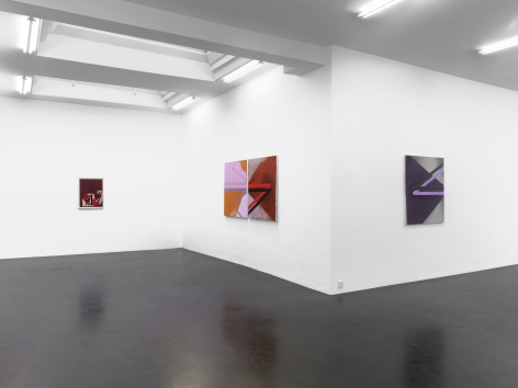 installation image of three paintings hanging on a wall. one is small and red, the middle is larger and made of pink, orange and red lines and color blocking, the third is purple and gray. all three hang on white walls.