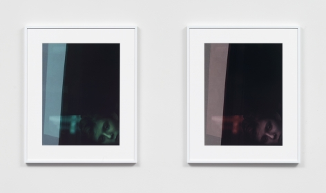 two framed photographs in white frames hanging side by side. the left image is a portrait of Barron Trump tinted green and the right hand image is the same, but tinted rose