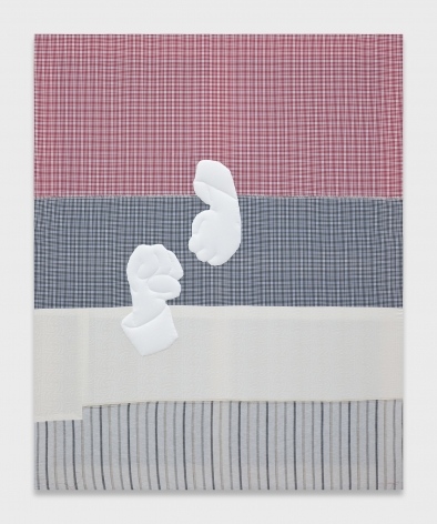 Four large blocks of fabric sewn together to make one large canvas. In descending order, the fabrics are red and gingham, dark blue gingham, white, and light blue and gray striped. Appliquéd onto the fabric canvas are two white fists that look like they are going to punch each other.