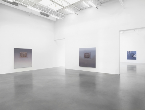 installation image of Todd at Petzel gallery. two of his arial view street paintings are hanging on the walls. looking through into another side gallery, you can see a figurative work hanging.