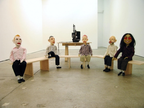 Untitled 2005 5 puppets each with ceramic head, feet and hands, synthetic hair, clothes, stuffing