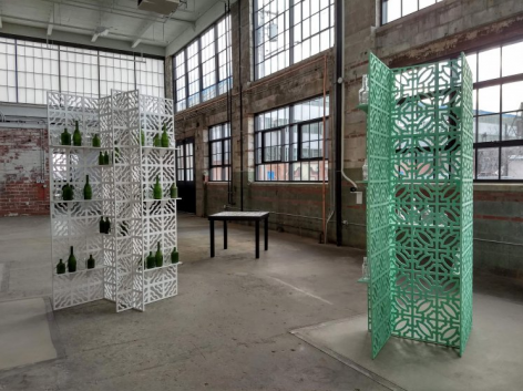 Open 24 Hours, 2018, Three self-standing screen units, found glass bottles, casting table