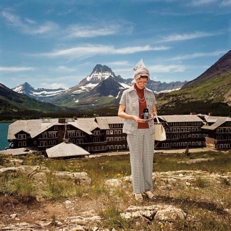 Woman Taking Photograph at Many Glacier Hotel, Glacier National Park, Montana