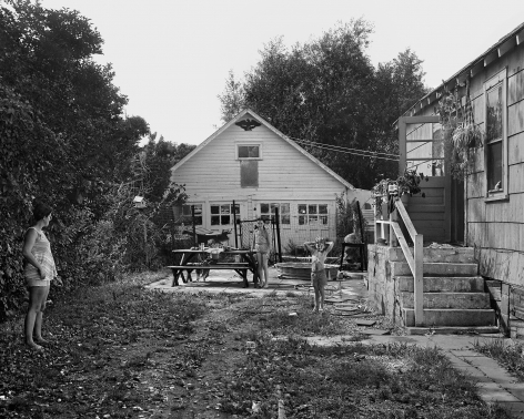 Woman and Children in their Yard