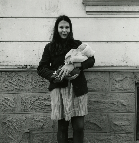 Woman Holding baby in Snow Suit, Cole Street, Haight Ashbury, 1968