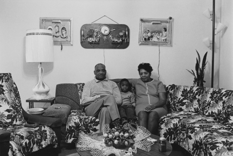 Husband and wife at home with their youngest child , 1968