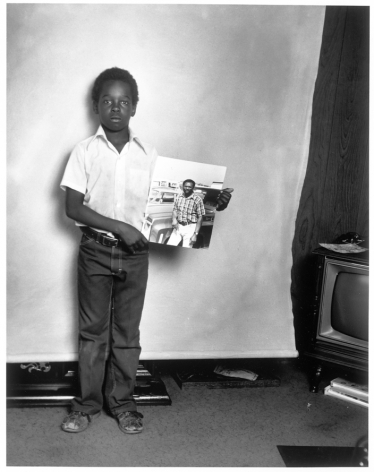 Leon Borensztein, Black Boy with Picture of His Father, Fremont, California, 1979