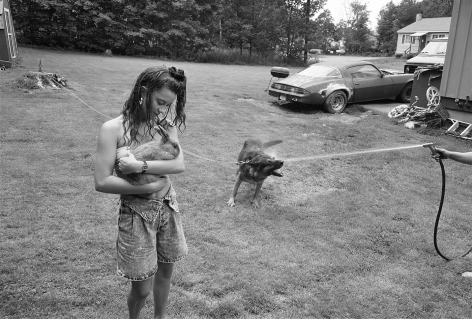 Girl with rabbit and German Shepherd, Laconia, New Hampshire, 1992