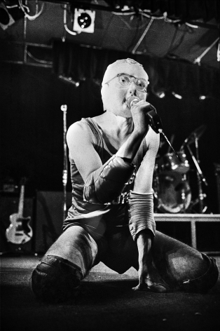 Michael Grecco, Devo performs on stage, 1978