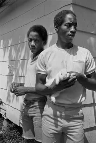 Young men with rabbit, Baton Rouge, Louisiana - 1983