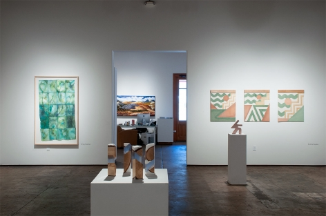 Installation shot of U.C.S.B. M.F.A. 20/20 Exhibition with pieces by Mary Heebner, R. Nelson Parrish, and Nathan Hayden with Phoebe Brunner in background