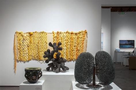 Installation photograph of ORGANIC: Textural & Biomorphic • Abstract & Conceptual: Clay, Wood, Fiber, Paper & Metal, James Haggerty, Brad Miller, Harry Bertoia, and Minga Opazo with Patricia Chidlaw in background