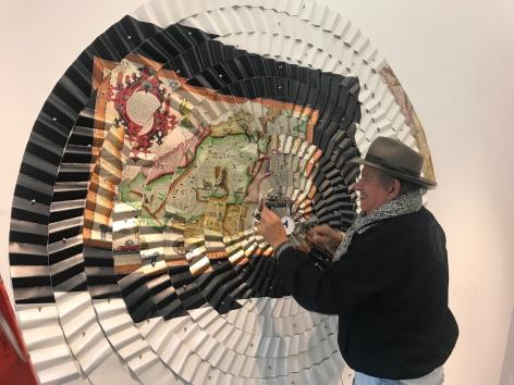 Miguel Ángel Ríos, installing Las estrellas nos guían at Sicardi   Ayers   Bacino 2019 Torn to Shreds [1992-93 Cibachrome mounted on pleatedcanvas and push pins, 112 9/16 x 91 5/16 in.]