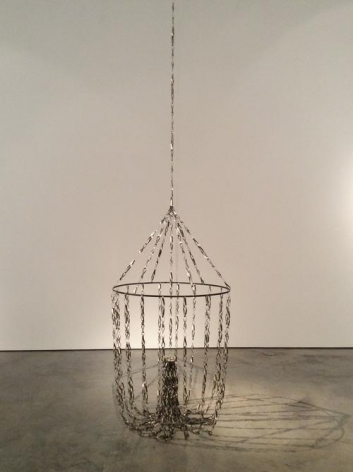 Pedro Tyler, Deriva, 2014. Metal measuring tape and steel, Variable height x 37 in.