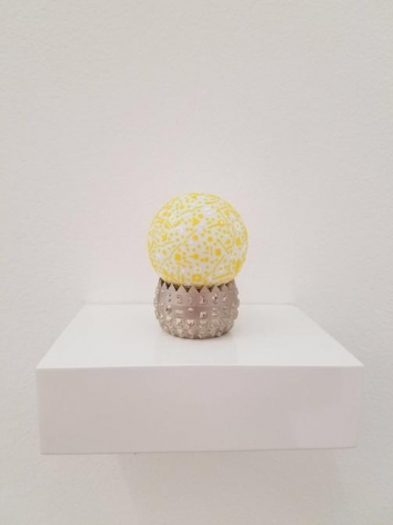 Marco Maggi, Language in Residence. Paper cuts on pong pong ball at IBM Selectric font ball, 3 1/2 x 4 1/8 x 3 in. / 8.9 x 10.5 x 7.6 cm.
