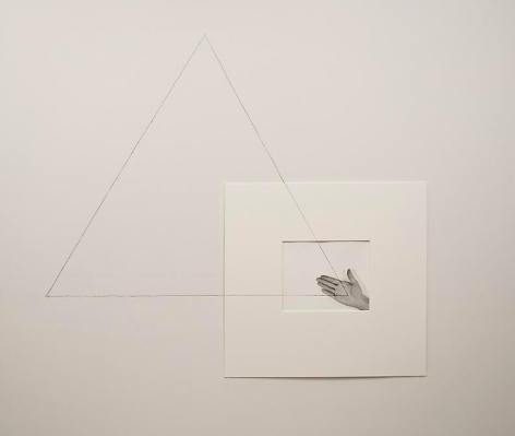 Liliana Porter, Untitled (triangle with one hand / right), 1973. Gelatin silver photograph with graphite pencil line, 14 in. x 11 in.