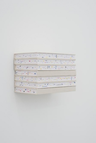Marco Maggi, Stacking Quotes, 2013. Cuts on printed stickers in 7 notebooks with canvas cover, invisible shelf,  5 1/2 in. x 11 in. x 7 in.