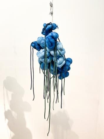 Sandra Monterroso, Puntos en resistencia azul. Edition. 6/13, 2019. Installation Indigo dyed yarn, loop, steel rope, 13 knots, 47 3/16 x 47 3/16 in.