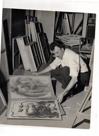 Alejandro Otero over some of his drawings at his studio in San Antonio de los Altos, Venezuela, 1960. Photo courtesy of the Otero Pardo Foundation Archives.