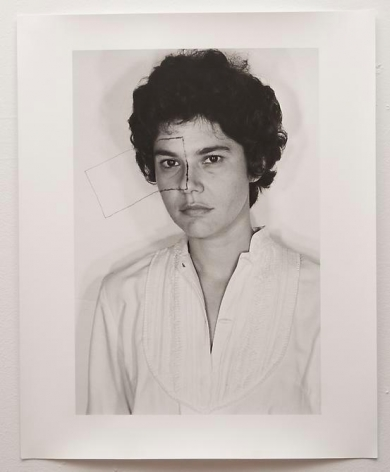Liliana Porter, Untitled (Self portrait with square), 1973. Modern gelatin silver photograph, 20 in. x 16 in.