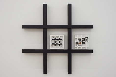 Marco Maggi, HO2 (Helio Oiticica Wall Unit), 2013. Two Metaesquema Turner boxes with cuts and folds on 500 pages each, 9 in. x 9 in. x 3 in.