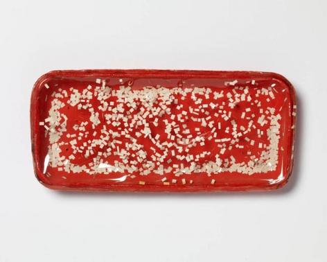 """Sérvulo Esmeraldo, Foodtainer 1, 1966. Red box, plastic film, paper, 4-3/4"""" x 8-3/4"""" x 7/8"""" /  12 x 22.2 x 2.2 cm"""