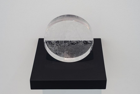 Marco Maggi, Portable Infinite, 2013. X-Acto knife cuts on solid polycast Plexi wheel, 8 in. diameter x 2 in.