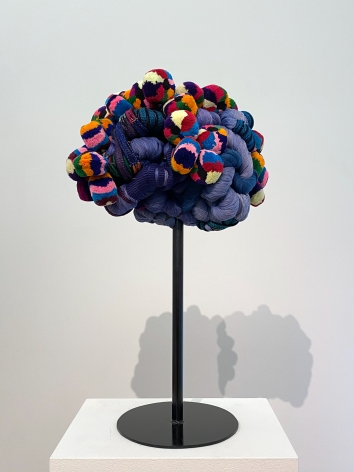 """Sandra Monterroso, Vida azul. From the series """" Wounds can also be dyed blue."""", 2019. Sculpture, yarn dyed with indigo, and Tocoyales [headdresses made of textiles, part of Mayan clothing in western Guatemala]. Assembled in steel., 23 9/16 x 23 9/16 x 15 3/4 in."""