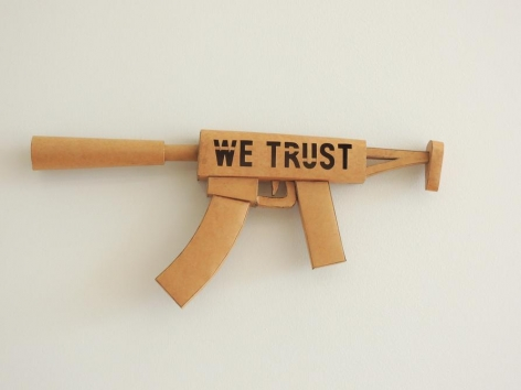 Miguel Angel Ríos, WE TRUST, 2011. Mexican craft paper, 9 x 21 x 1 3/4 in.
