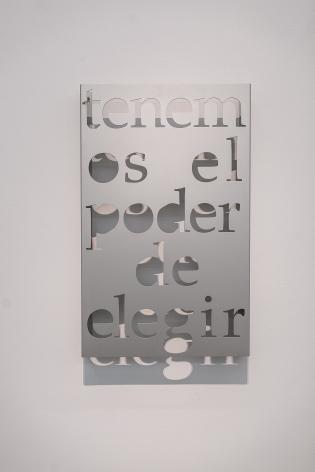 Marie Orensanz, Tenemos el poder de elegir, 2010. Hydro-cut Aluminum, 20 x 31 3/4 x 3 in.