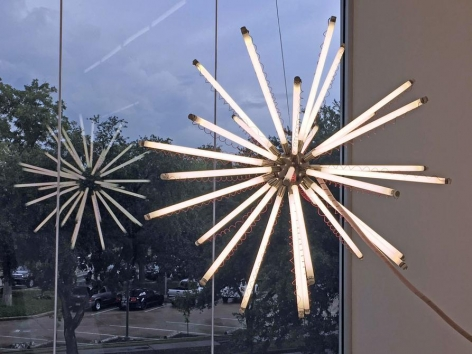 Thomas Glassford, Aster 140 T8/4100 K (Red), 2003. Fluorescent light, nickel plated brass, orange wire, red wire, electrical hardware, ∅ 55 in. / ∅ 140 cm.