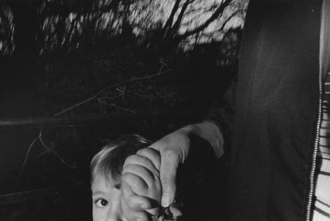 Boy's Eye and Man's Hand, 1974, 16 x 20 inch gelatin silver print