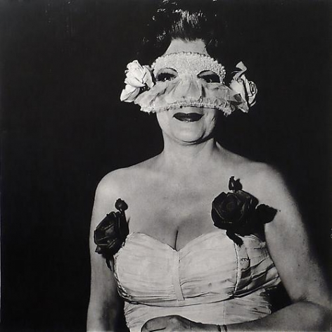 Diane Arbus Lady at a masked ball with two roses on her dress.  N.Y.C.  1967