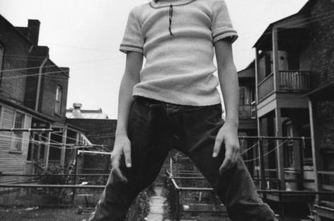 Defiant Girl up on Fence, October 1973, 16 x 20 inch vintage gelatin silver print