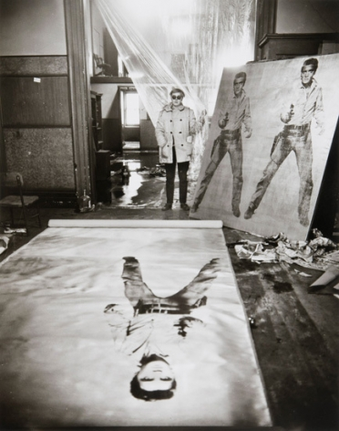 Andy Warhol (in his Studio with Elvis Presley Print), New York, 1962