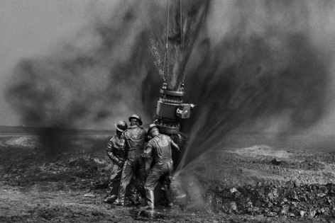 Workers Struggle To Remove Bolts, Oil Wells, Kuwait. 1991