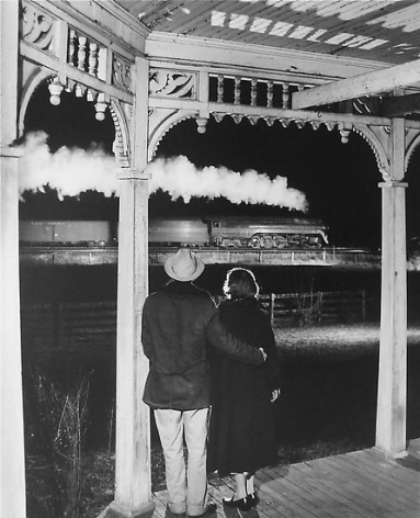 Mr. and Mrs. Ben Pope watch the last steam powered passenger train. Max Meadows, Virginia 1958