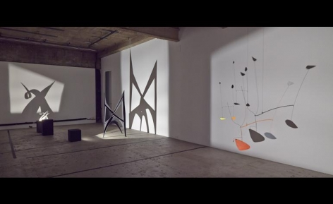 The novel display was inspired by archival images of Calder installing his sculptures in darkness and photographing them using directed light. The images caught the eye of the gallery's founder, Adam Lindemann, who decided to reorientate Calder's familiar aesthetic